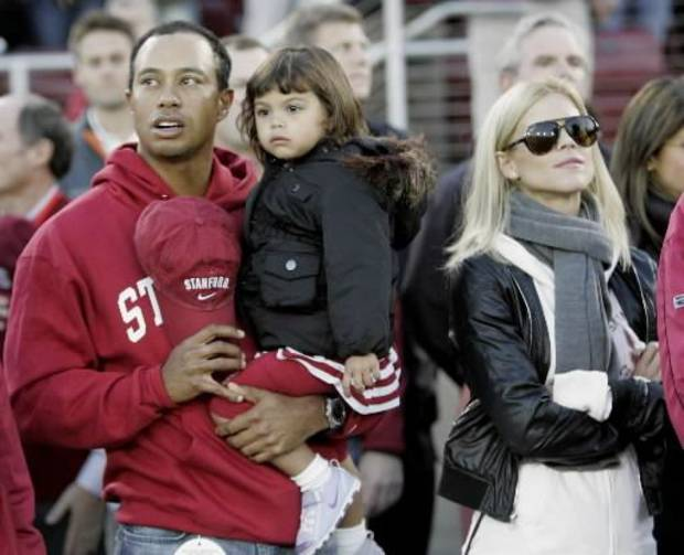 Tiger Woods with his wife and daughter at a college football game.  (AP Photo/Marcio Jose Sanchez)