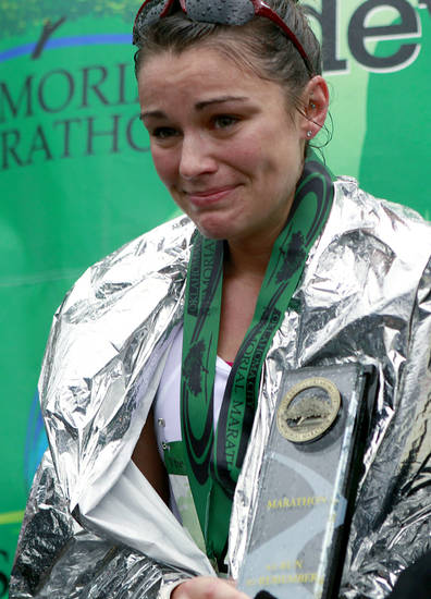Alaina Zanin reacts as she is presented with a trophy for winning the 11th Annual Oklahoma City Memorial Marathon in Oklahoma City on Sunday, May 1, 2011. Photo by John Clanton, The Oklahoman