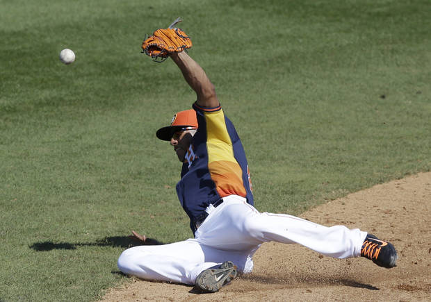 Houston Astros shortstop Carlos Correa misplays a single hit by Toronto Blue Jays Ryan Langerhans during the eighth inning of a spring training baseball game in Kissimmee, Fla., Sunday, March 9, 2014. (AP Photo/Carlos Osorio)