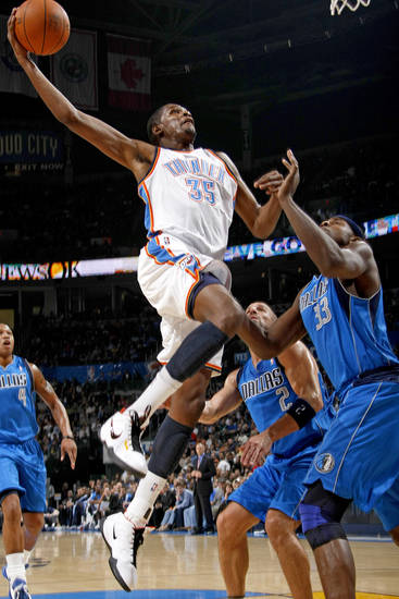 Oklahoma City's Kevin Durant goes to the basket in front of Brendan Haywood, right, and Jason Kidd during the NBA basketball game between the Oklahoma City Thunder and the Dallas Mavericks at the Oklahoma City Arena on Wednesday, Nov. 24, 2010.   Photo by Bryan Terry, The Oklahoman
