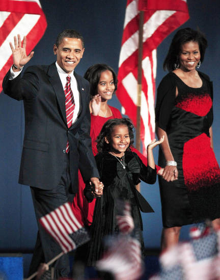President-elect Barack Obama and his wife, Michelle, and their daughters, Malia, 10, and Sasha, 7, arrive Tuesday night during his party at Grant Park in Chicago. AP Photo