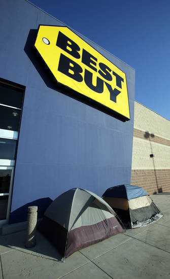 The first Black Friday campers were spotted Tuesday outside the Best Buy in Moore. Financial experts say it's essential to factor spending into a Black Friday plan. Photo by Steve Sisney, The Oklahoman Archive <strong>STEVE SISNEY - THE OKLAHOMAN</strong>