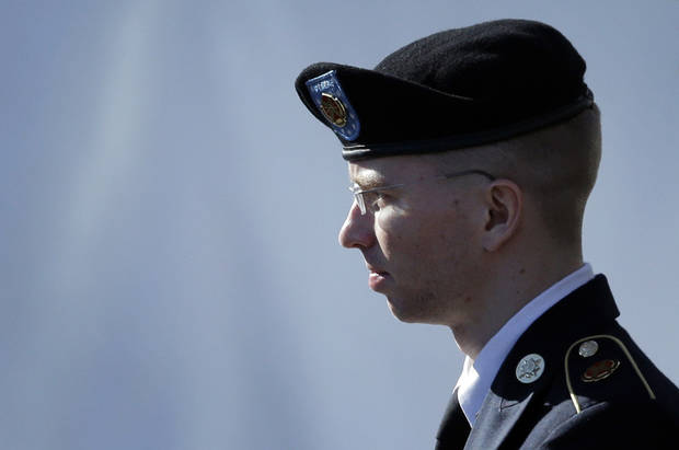 Army Pfc. Bradley Manning is escorted out of a courthouse in Fort Meade, Md., Tuesday, June 4, 2013, after the second day of his court martial. Manning is charged with indirectly aiding the enemy by sending troves of classified material to WikiLeaks. He faces up to life in prison. (AP Photo/Patrick Semansky)
