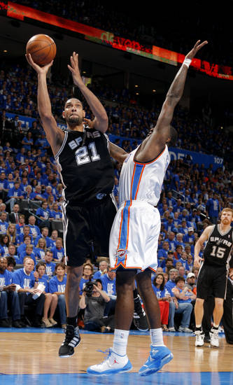 San Antonio's Tim Duncan (21) shoots as Oklahoma City's Kendrick Perkins (5) defends during Game 3 of the Western Conference Finals between the Oklahoma City Thunder and the San Antonio Spurs in the NBA playoffs at the Chesapeake Energy Arena in Oklahoma City, Thursday, May 31, 2012.  Photo by Sarah Phipps, The Oklahoman