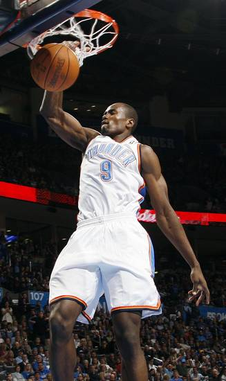Oklahoma City's Serge Ibaka dunks the ball in the first half during an NBA basketball game between the Oklahoma City Thunder and the Dallas Mavericks at Chesapeake Energy Arena in Oklahoma City, Thursday, Dec. 29, 2011. Photo by Nate Billings, The Oklahoman