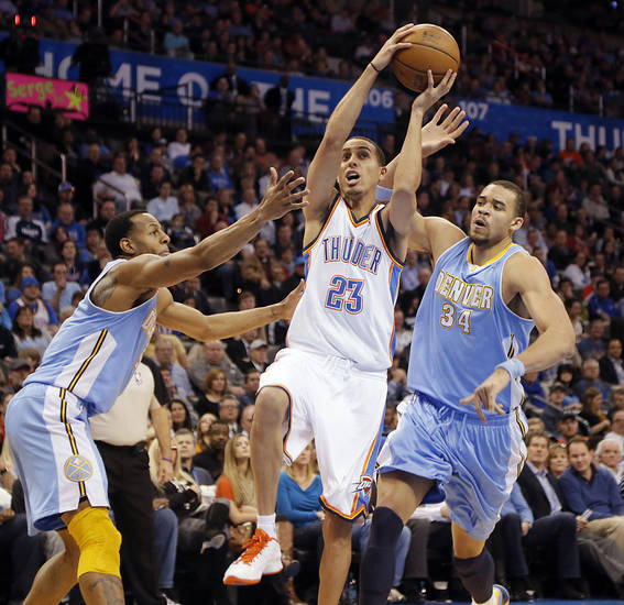 Oklahoma City's Kevin Martin (23) drives past Denver's Andre Iguodala (9) and JaVale McGee (34) during the NBA basketball game between the Oklahoma City Thunder and the Denver Nuggets at the Chesapeake Energy Arena on Wednesday, Jan. 16, 2013, in Oklahoma City, Okla.  Photo by Chris Landsberger, The Oklahoman