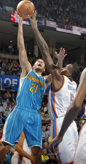 Oklahoma City Thunder's Kendrick Perkins (5) defends on New Orleans Hornets' Greivis Vasquez (21) during the NBA basketball game between the Oklahoma CIty Thunder and the New Orleans Hornets at the Chesapeake Energy Arena on Wednesday, Dec. 12, 2012, in Oklahoma City, Okla.   Photo by Chris Landsberger, The Oklahoman