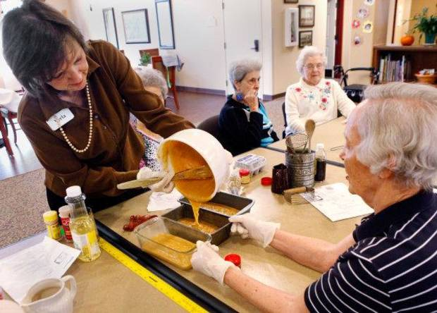 Alzheimer's patients use bread-making as therapy at the Touchmark Coffee Creek Assisted Living Center on Nov. 16. That day, the women made pumpkin bread in advance of Thanksgiving. Photo by Jim Beckel, The Oklahoman <strong>JIM BECKEL</strong>