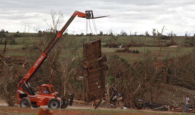 A lift truck removes what is left of a trailer west of El Reno, Wednesday, May 25, 2011. Photo by Chris Landsberger, The Oklahoman