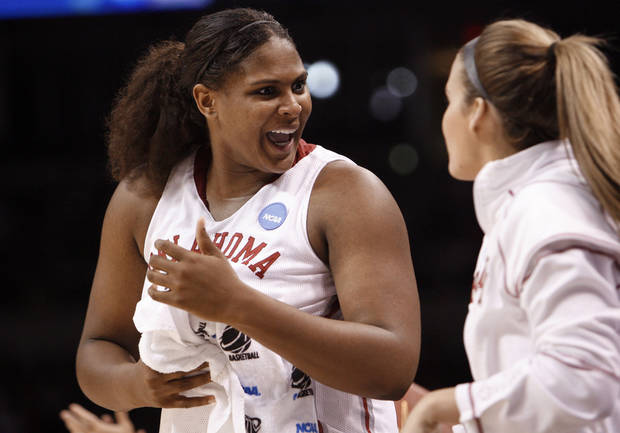 Courtney Paris and Whitney Hand celebrate in the second half of the NCAA women's basketball tournament game between the University of Oklahoma and Pittsburgh at the Ford Center in Oklahoma City, Okla. on Sunday, March 29, 2009. 