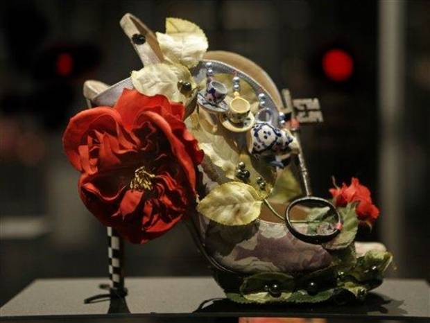This Feb. 11, 2013 photo shows a shoe decorated with a miniature tea set and a lock titled &quot;Alice,&quot; and designed by Nicholas Kirkwood, on display at the &quot;Shoe Obsession&quot; exhibit at The Museum at the Fashion Institute of Technology Museum in New York. The exhibition, showing off 153 specimens, runs through April 13. (AP Photo/Kathy Willens)