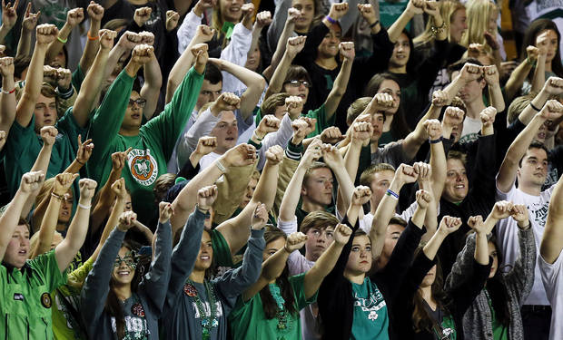 Bishop McGuinness fans raise their arms for a free throw attempts during a Class 5A boys high school basketball game in the semifinals of the state tournament at the Mabee Center in Tulsa, Okla., Friday, March 8, 2013. Bishop McGuinness beat Chickasha, 50-40. Photo by Nate Billings, The Oklahoman