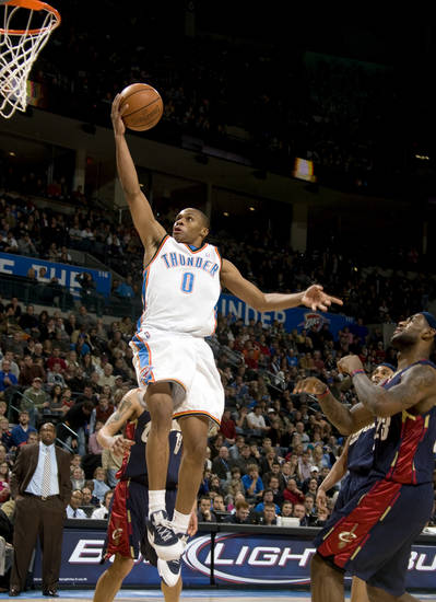 Oklahoma City's Russell Westbrook (0) shoots a lay up in front of Cleveland's LeBron James during the NBA game between the Oklahoma City Thunder and Cleveland Cavaliers, Sunday, Dec. 21, 2008, at the Ford Center in Oklahoma City. PHOTO BY SARAH PHIPPS, THE OKLAHOMAN