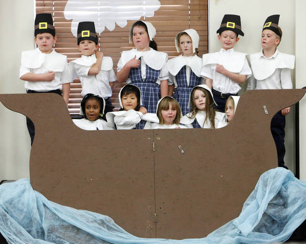First-graders dressed as pilgrims sing on the Mayflower for the Thanksgiving pageant at St. Mary�s Episcopal School.