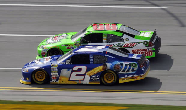Brad Keselowski (2) and Dale Earnhardt Jr. (88) race through the tri-oval during the Good Sam Club 500 NASCAR Sprint Cup auto race at Talladega Superspeedway in Talladega, Ala., Sunday, Oct. 7, 2012. (AP Photo/Rainier Ehrhardt)