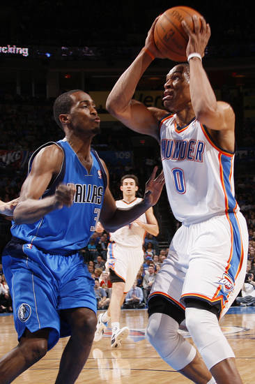 Oklahoma City's Russell Westbrook (0) works against Dallas' Rodrigue Beaubois (3) during the NBA basketball game between the Oklahoma City Thunder and the Dallas Mavericks at Chesapeake Energy Arena in Oklahoma City, Monday, March 5, 2012. Photo by Nate Billings, The Oklahoman