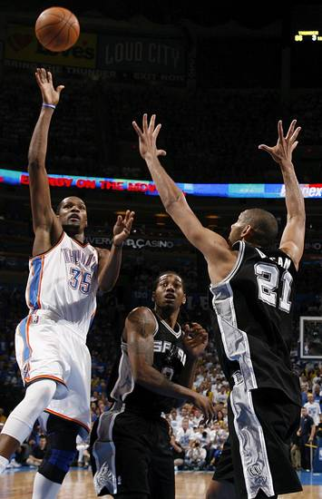 Oklahoma City's Kevin Durant (35) shoots against San Antonio's Kawhi Leonard (2) and Tim Duncan (21) in the fourth quarter during Game 4 of the Western Conference Finals between the Oklahoma City Thunder and the San Antonio Spurs in the NBA playoffs at the Chesapeake Energy Arena in Oklahoma City, Saturday, June 2, 2012. Oklahoma City won, 109-103. Photo by Nate Billings, The Oklahoman