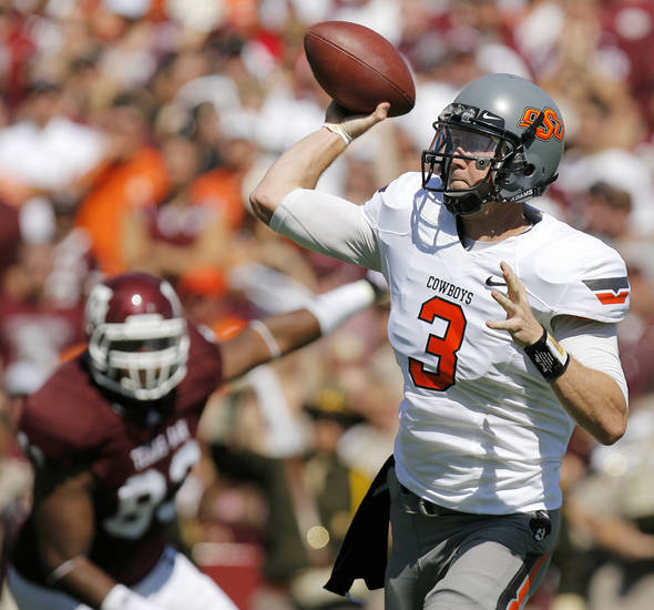 OSU quarterback Brandon Weeden passes during the Cowboys' 30-29 win over Texas A&M on Saturday. Photo by Nate Billings, The Oklahoman
