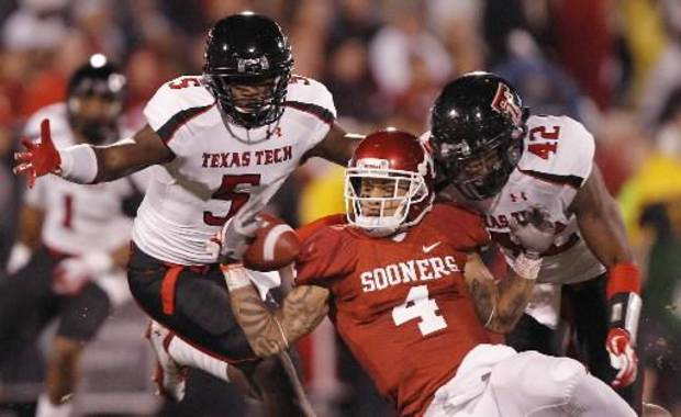 Texas Tech's Tre' Porter (5) and Daniel Cobb (42) break up a pass for Oklahoma's Kenny Stills (4) at the Gaylord Family- Oklahoma Memorial Stadium on Saturday, Oct. 22, 2011. in Norman, Okla. (Photo by Chris Landsberger, The Oklahoman)