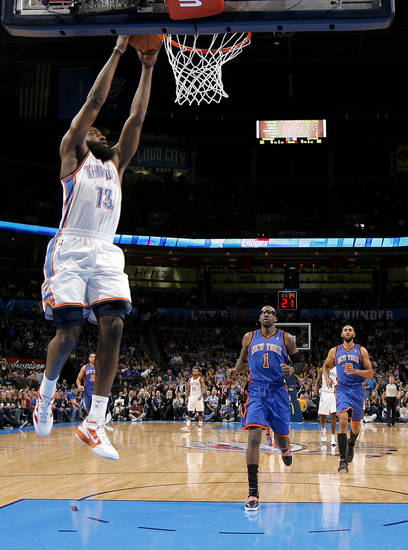 Oklahoma City's James Harden (13) dunks the ball as New York's Amare Stoudemire (1) watches during the NBA game between the Oklahoma City Thunder and the New York Knicks at Chesapeake Energy Arena in Oklahoma CIty, Saturday, Jan. 14, 2012. Photo by Bryan Terry, The Oklahoman