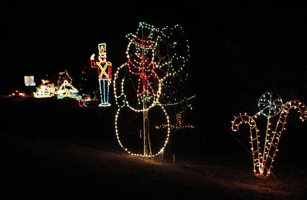 Cars drive through Joe B. Barnes Regional Park during the opening ceremony of the Midwest City Holiday Lights Spectacular.