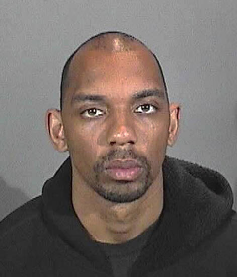 This 2009 photo from the Hermosa Beach, Calif., Police Department shows Brandon Lincoln Woodard.  Woodard, 31, was shot in the head Monday, Dec. 10, 2012, in the New York City borough of Manhattan, in what looked like a professional killing. (AP Photo/Hermosa Beach PD)