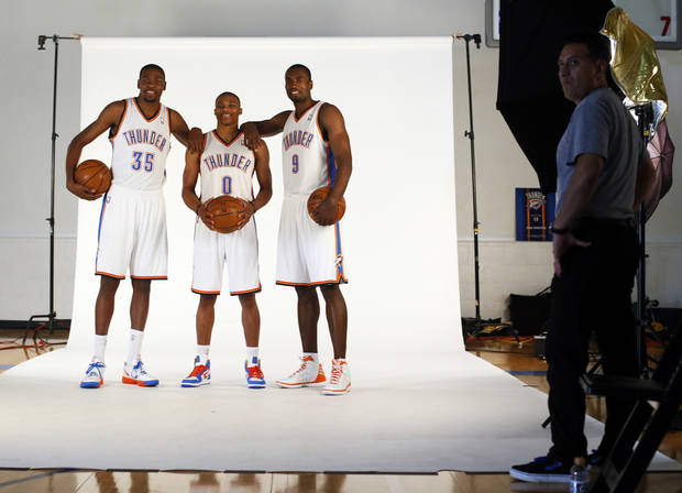 From left, Kevin Durant, Russell Westbrook and Serge Ibaka have their picture taken during media day for the Oklahoma City Thunder NBA basketball team at the Thunder Events Center in Oklahoma City, Monday, Oct. 1, 2012.  Photo by Nate Billings, The Oklahoman