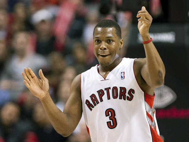Toronto Raptors guard Kyle Lowry celebrates after scoring a basket against the Chicago Bulls during the first half of NBA basketball game in Toronto on Wednesday, Jan. 16, 2013. (AP Photo/The Canadian Press, Nathan Denette)