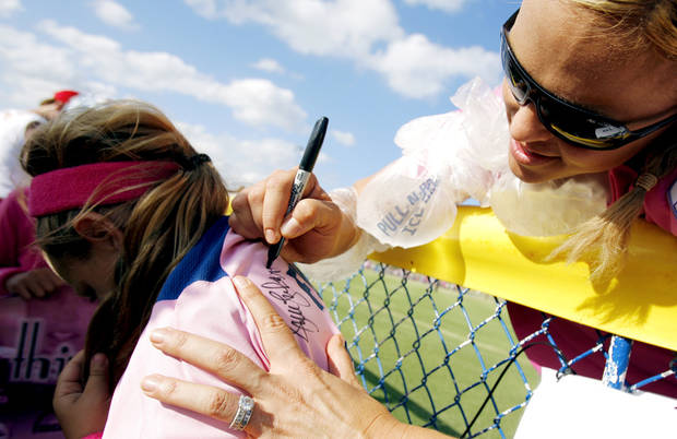 Jennie Finch signs a shirt worn by Brycelyn Richards, 7, from Italy, Texas, following the exhibition softball game between Team USA and Team Canada at ASA Softball Stadium in Oklahoma City, Saturday, June 7, 2008. BY MATT STRASEN, THE OKLAHOMAN