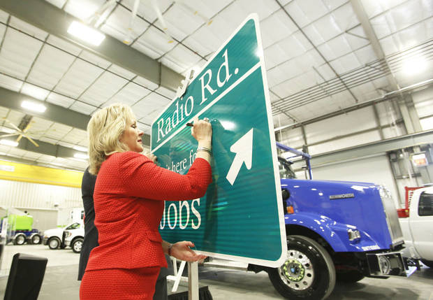 Gov. Mary Fallin autographs a sign Friday during the groundbreaking ceremony for the new Radio Road and Interstate 40 interchange in El Reno.   Photo By Steve Gooch, The Oklahoman
