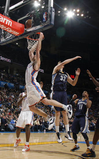 Oklahoma City�s Nick Collison (4)dunks in front of Memphis' Marc Gasol during the NBA basketball game between the Oklahoma City Thunder and the Memphis Grizzlies, Saturday, Jan. 8, 2011, at the Oklahoma City Arena. Photo by Sarah Phipps, The Oklahoman
