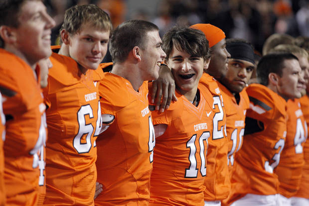 Oklahoma State's Clint Chelf (10) and J.W. Walsh (4) sing following a college football game between Oklahoma State University and the Texas Tech University (TTU) at Boone Pickens Stadium in Stillwater, Okla., Saturday, Nov. 17, 2012. Photo by Sarah Phipps, The Oklahoman