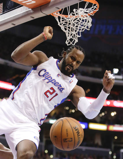 Los Angeles Clippers center Ronny Turiaf celebrates after dunking against the Sacramento Kings during the first half of an NBA basketball game in Los Angeles, Friday, Dec. 21, 2012. (AP Photo/Chris Carlson)