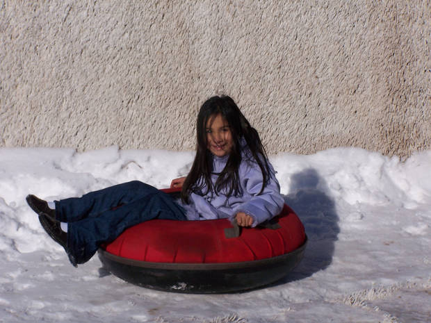 Grace Mathew tries out snow tubing at the Bricktown Ballpark.<br/><b>Community Photo By:</b> Cindi Tennison<br/><b>Submitted By:</b> Cindi , Bethany