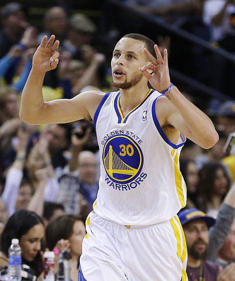 Golden State Warriors' Stephen Curry celebrates after scoring against the Utah Jazz during the first half of an NBA basketball game, Sunday, April 7, 2013, in Oakland, Calif. (AP Photo/Ben Margot)