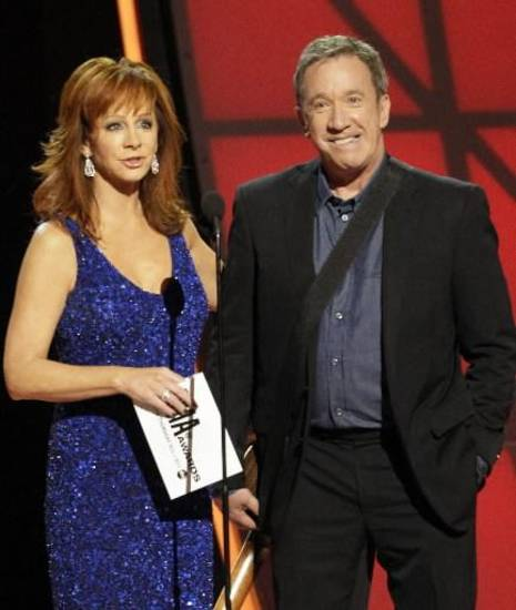 Oklahoma native Reba McEntire and Tim Allen present an award Thursday night at the 2012 CMA Awards. (AP photos)
