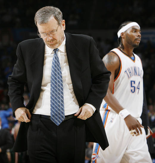 Thunder head coach P.J. Carlesimo walks to the coaching huddle during a time out as Chris Wilcox heads ot the bench during the NBA basketball game between the Oklahoma City Thunder and the Milwaukee Bucks at the Ford Center in Oklahoma City, Wednesday, Oct. 29, 2008. This was the regular season debut of the Thunder. Milwaukee won, 98-87. BY NATE BILLINGS, THE OKLAHOMAN