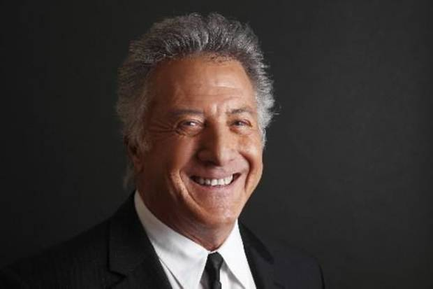 Dustin Hoffman is credited with saving the life of a London jogger having a heart attack.