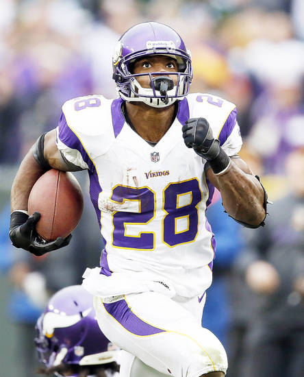 Former OU running back Adrian Peterson is likely to lead the NFL in rushing this season. AP photo