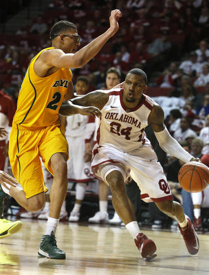 Oklahoma Sooner's Romero Osby (24) drives past Baylor Bear's Isaiah Austin (21) in the second half as the University of Oklahoma Sooners (OU) men defeat the Baylor University Bears (BU) 90-76 in NCAA, college basketball at The Lloyd Noble Center on Saturday, Feb. 23, 2013  in Norman, Okla. Photo by Steve Sisney, The Oklahoman