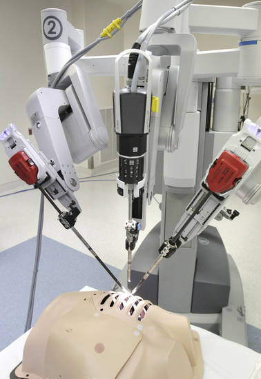 This is a new surgical robot which is being used to perform gall bladder surgery at the OU Medical Center in Edmond, OK, Monday, March 19, 2012,  The device is controlled remotely by a doctor at a console. By Paul Hellstern, The Oklahoman