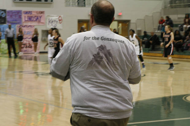 Edmond Santa Fe girls basketball coach Paul Bass wears a tee-shirt in honor of the family of senior Daisha Gonzaque, whose father died Monday. PHOTO BY JASON KERSEY, THE OKLAHOMAN KOD