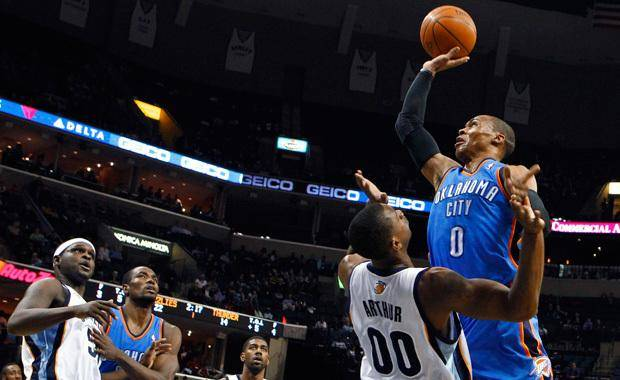 Oklahoma City Thunder&#039;s Russell Westbrook (0) drives while being fouled by Memphis Grizzlies&#039; Darrell Arthur (00) as Grizzlies&#039; Zach Randolph, left; Thunder&#039;s Serge Ibaka, second from left; and Grizzlies&#039; O.J. Mayo, middle, look on during the first half of an NBA basketball game in Memphis, Tenn., Monday, March 7, 2011. (AP Photo/ Mark Weber)