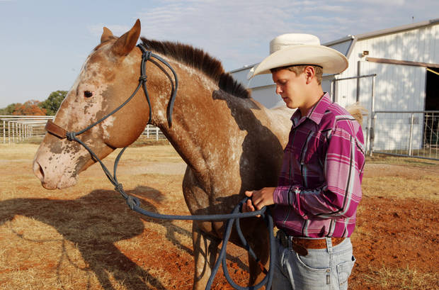 Resident Trent Henry, age 12, with one of the horses just after sunrise at Boys Town Ranch in Edmond Wednesday, Aug. 8, 2012.  Photo by Paul B. Southerland, The Oklahoman