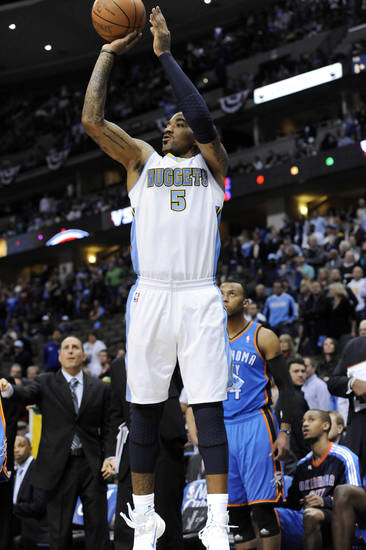 Denver Nuggets guard J.R. Smith (5) shoots a three-point shot during the second half of game 3 of a first-round NBA basketball playoff series against the Oklahoma City Thunder  Saturday, April 23, 2011, in Denver. Oklahoma City beat Denver 97-94 to take a 3-0 series lead. (AP Photo/Jack Dempsey)