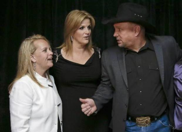 Mary Chapin Carpenter, left, talks with Garth Brooks, right, and Trisha Yearwood before the Nashville Songwriters Hall of Fame inductions on Sunday, Oct. 7, 2012, in Nashville, Tenn. Carpenter was one of the inductees.
