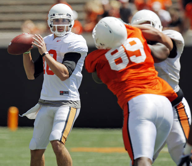 OSU's Clint Chelf (10) looks to pass during the Orange/White spring football game for the Oklahoma State University Cowboys at Boone Pickens Stadium in Stillwater, Okla., Saturday, April 16, 2011. Photo by Nate Billings, The Oklahoman
