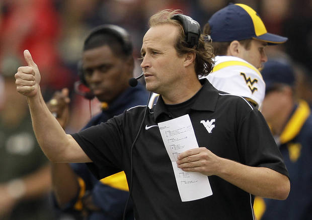 West Virginia head coach Dana Holgorsen signals his players in the second half of an NCAA football game against Maryland in College Park, Md., Saturday, Sept. 17, 2011. West Virginia won 37-31. (AP Photo/Patrick Semansky) ORG XMIT: MDPS112