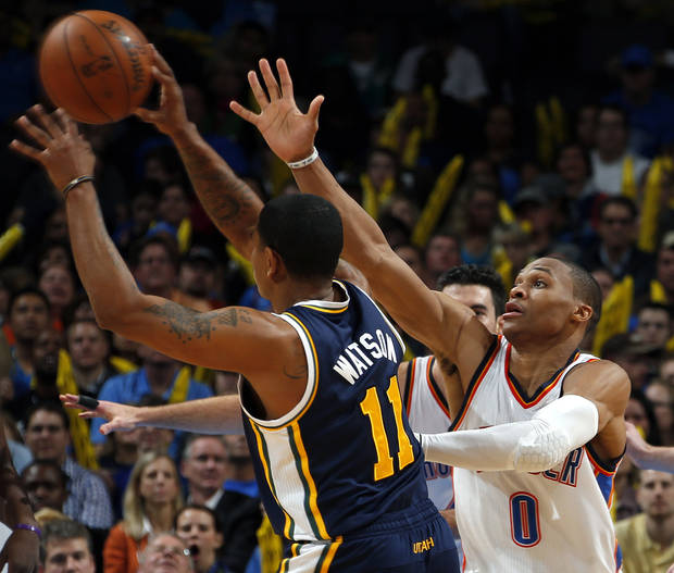 Oklahoma City's Russell Westbrook (0) defends against Utah's Earl Watson (11) during the NBA game between the Oklahoma City and the Utah Jazz and the Chesapeake Energy Arena, Friday,Nov. 30, 2012. Photo by Sarah Phipps, The Oklahoman