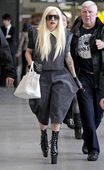 Singer Lady Gaga arrives at the New Tokyo International Airport in Narita, east of Tokyo, for her Japan tour concerts in Kobe and Yokohama, Tuesday, April 13, 2010. (AP Photo/Shuji Kajiyama) ORG XMIT: XKAJ101